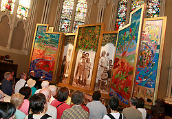 Aug 13, 2006; Toronto, ON, Canada; The Keiskamma Altarpiece was unveiled tonight at St. James Cathedral. Measuring 6.5 meters wide by 4 meters high, the formidable piece was created by over 120 women and men from the Eastern Cape of South Africa - one of the areas of Africa hardest hit by HIV/AIDS - and is athree part, beaded, quilted, and photographic homage to the loved ones they have lost to the disease. ''The Keiskamma Altarpiece acknowledges the profoundly painful impact of the AIDS epidemic on the community while celebrating the response of its members, especially the women, in caring for those inneed,'' says Dr. Carol Hofmeyr, director of the Keiskamma Trust. Dr. Hofmeyr was there along with one of the grandmothers featured in the piece, Eunice Mangwane - who is looking after a grandson with AIDS. Pictured: Dr. Carol Hofmeyr tells the stories behind the artwork to the crowd as the panels are turned over and the next layer revealed. Mandatory Credit: Photo by Tory Zimmerman/Toronto Star/ZUMA Press. (©) Copyright 2006 by Toronto Star