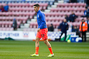 Huddersfield Town forward Kian Harratt warming up before the EFL Sky Bet Championship match between Wigan Athletic and Huddersfield Town at the DW Stadium, Wigan, England on 14 December 2019.
