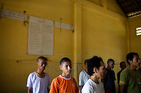 Drug abusers line up in a classroom at Orkas Khnom, or My Chance, a government-run facility where youth and young men are brought here by their families or by arrest from police to be re-educated from drug addiction, just outside Phnom Penh, Cambodia, on Tuesday, May 11, 2010.