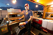 "Aureliano Dominguez owner of ""El Caprichoso"" Sonora Mexico style hot dogs poses for a photo in downtown Phoenix on August 19, 2016."