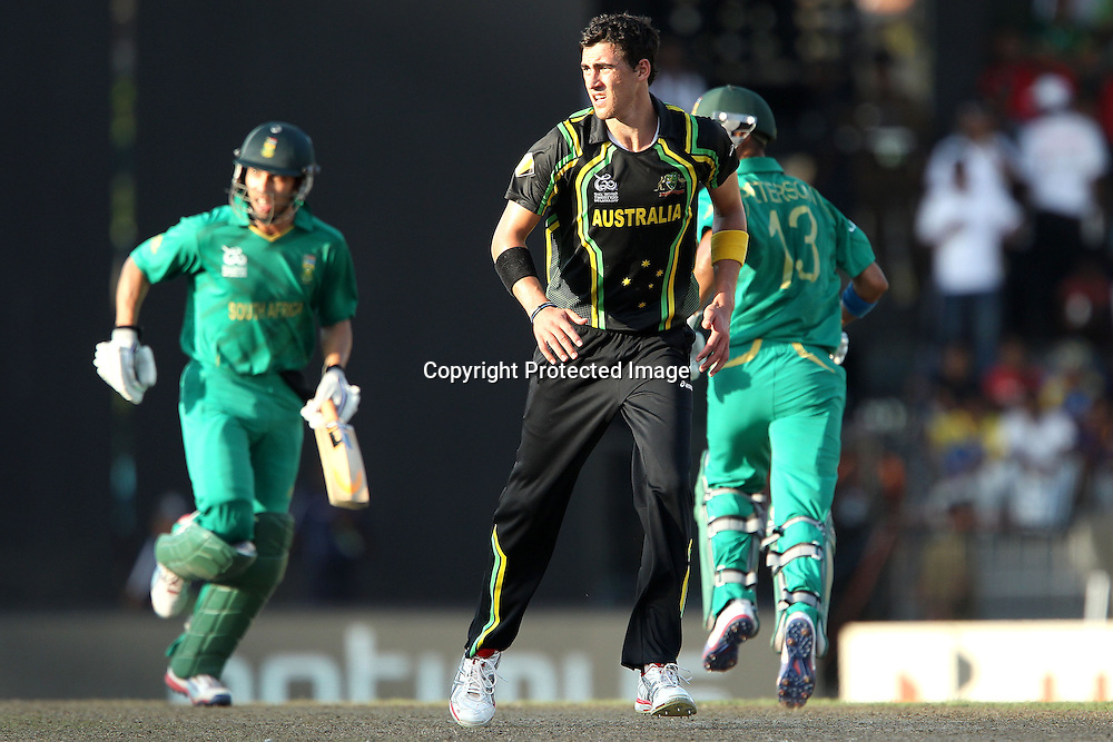 Mitchell Starc looks on as Robin Pieterson and Farheen Behardien make the runs during the ICC World Twenty20 Super 8s match between Australia and South Africa held at the Premadasa Stadium in Colombo, Sri Lanka on the 30th September 2012<br /> <br /> Photo by Ron Gaunt/SPORTZPICS