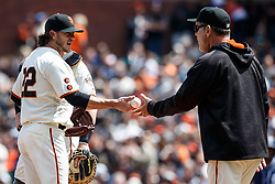 SAN FRANCISCO, CA - MAY 25: Jake Peavy #22 of the San Francisco Giants is relieved by manager Bruce Bochy #15 during the seventh inning against the San Diego Padres at AT&T Park on May 25, 2016 in San Francisco, California.  (Photo by Jason O. Watson/Getty Images) *** Local Caption *** Jake Peavy; Bruce Bochy