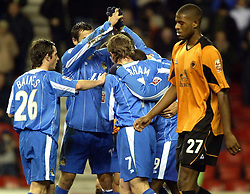 WIGAN, ENGLAND - Tuesday, January 4, 2005: Wolverhampton Wanderers' Carl Court looks dejected as Wigan Athletic's players celebrate their second goal during the League Championship match at the JJB Stadium. (Pic By Dave Kendall/Propaganda)