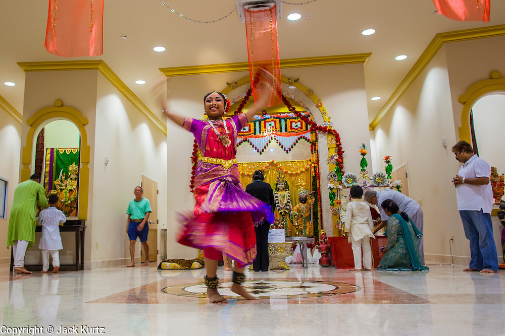 10 AUGUST 2012 - PHOENIX, AZ: A dancer performs during Janmashtami celebrations at Ekta Mandir, a Hindu temple in central Phoenix. Janmashtami is the Hindu holy day that celebrates the birth of Lord Krishna. Hindu communities around the world celebrate the holy day. In Arizona, most of the Hindu temples in the Phoenix area have special celebrations of the day.  PHOTO BY JACK KURTZ