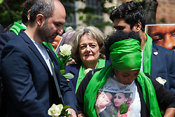 London, UK. 14 June, 2019. Cllr Elizabeth Campbell (c), Leader of the Council of the Royal Borough of Kensington and Chelsea, joins family members to release doves of peace following a memorial service at St Helen's Church to mark the second anniversary of the Grenfell Tower fire on 14th June 2017 in which 72 people died and over 70 were injured.