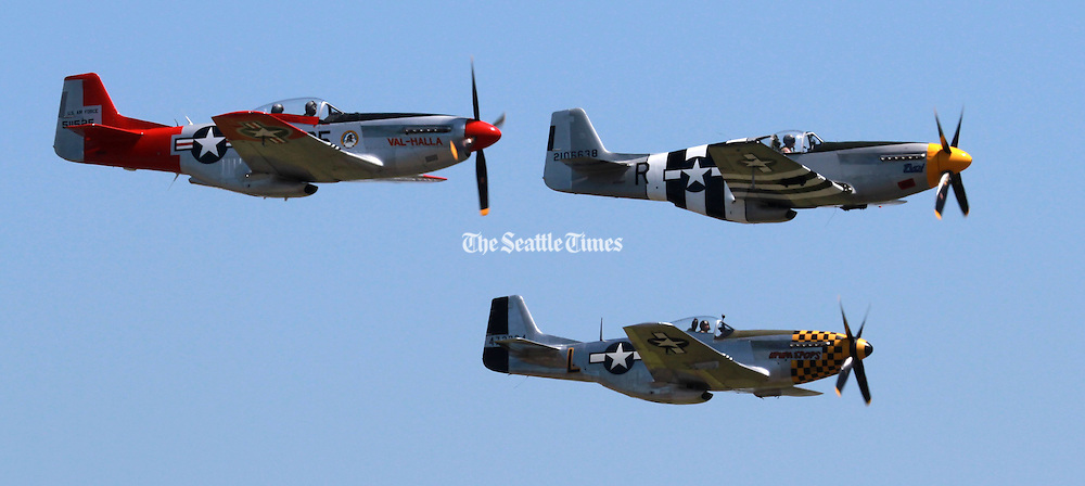 A restored P-51B Mustang that flew in the D-Day invasion flies over Paine field on the 70th anniversary of D-Day. The other two planes are P-51D Mustangs, but weren't involved in D-Day. The D-Day plane has &quot;invasion stripes&quot; which let allied planes know it was a friendly.<br />