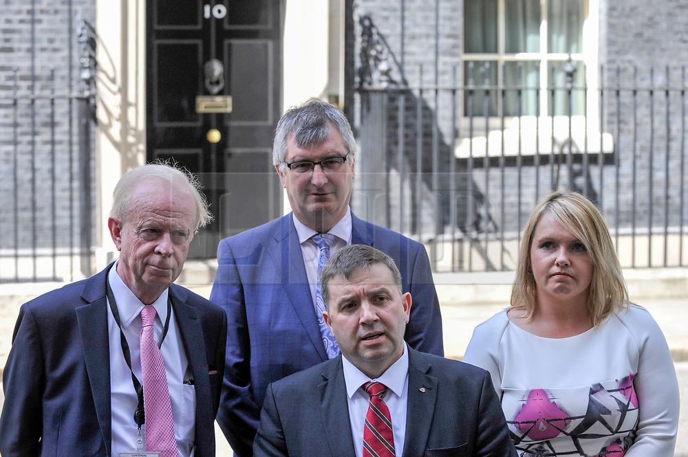 © Licensed to London News Pictures. 15/06/2017. London, UK. (C) Robin Swann, leader of the Ulster Unionist Party, flanked by (L to R) Sir Reg Empey, Tm Elliott and Jill Macauley, gives a press conference outside Number 10.  Members of the Northern Ireland Assembly visit Downing Street for talks with Prime Minister Theresa May following the results of the General Election.  The Conservatives are seeking to work with the Democratic Unionist Party in order to form a minority government. Photo credit : Stephen Chung/LNP