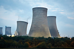 © Licensed to London News Pictures.  27/07/2014. DIDCOT, UK. The three cooling towers of Didcot A power station, each 113 meters tall,  being demolished using 160kg of high explosion. It took just 15 seconds. Photo credit: Cliff Hide/LNP