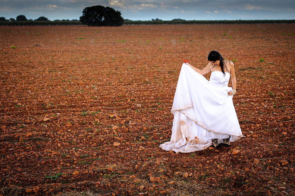 Decided to go into the  fields and trash the dress after the wedding in Spain. It started raining at the perfect time.