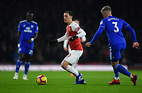 Football - 2018 / 2019 Premier League - Arsenal vs. Cardiff City<br /> <br /> Arsenal's Mesut Ozil holds off the challenge from Cardiff City's Joe Bennett, at The Emirates.<br /> <br /> COLORSPORT/ASHLEY WESTERN