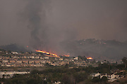 San Marcos, California, U.S. - <br /> <br /> California Wildfires 2014 - Cocos Fire<br /> <br /> Fires burn on the hillside seen from the city of Vista, California as the full moon rises. The Cocos Fire, formerly known as the Washingtonia Fire has already burned more than 450 acres in the Village Drive, Twin Oaks Road area of the North San Diego County city of San Marcos. <br /> ©Exclusivepix