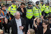 On the 10th consecutive day of protests around London by the climate change campaign Extinction Rebellion, police officers prepare to arrest campaigners under Section 14 of the Public Order Act, on 24th April 2019, at Marble Arch, London England.