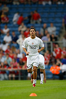 Photo: Marc Atkins.<br />Oxford United v Manchester United XI. Pre Season Friendly. 08/08/2006.  Christiano Ronaldo of Manchester United during the warm up.