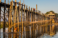 U BEIN BRIDGE, MYANMAR - NOVEMBER 28, 2016 : fisherman fishing U Bein Bridge Taungthaman Lake Amarapura  Mandalay state Myanmar (Burma)