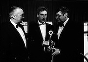 18/01/1989<br /> 01/18/1989<br /> 18 January 1989<br /> Texaco Sportstars of the Year Awards 1988 at the Burlington Hotel, Dublin. Picture shows Mr. Ray Burke T.D. (right), Minister for Industry and Commerce presenting the Texaco Sportstar of the Year Award for Cycling to Sean kelly of Tipperary. Mr. Vincent O'Brien, Managing Director of Texaco (Ireland) Ltd. on the left.