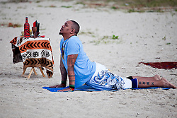 Akinyemi Blake leads a sunrise session of Hatha Yoga on Brewers Bay Beach to celebrate the sixth principle of Kwanzaa, Kuumba (creativity).