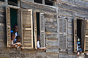 Residents watch from their windows during the parade held on the occasion of the annual Oguaa Fetu Afahye Festival in Cape Coast, Ghana on Saturday September 6, 2008..