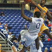 Delaware Guard Davon Usher (0) is fouled by  Hofstra Forward Stephen Nwaukoni (24) in the first half of a NCAA regular season Colonial Athletic Association conference game between Delaware and Hofstra Wednesday, JAN 8, 2014 at The Bob Carpenter Sports Convocation Center in Newark Delaware.