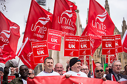 © Licensed to London News Pictures. 06/03/2019. LONDON, UK.  Workers from Honda's Swindon plant stage a demonstration outside the Houses of Parliament calling on MPs to save their factory from closing.  Honda recently announced that the plant will cease production in 2022 amidst uncertainty over the future post-Brexit.  Photo credit: Stephen Chung/LNP