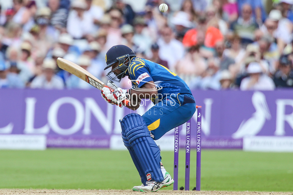 Sri Lanka's Seekkuge Prasanna ducks a delivery from Englands Chris Woakes during the Royal London ODI match between England and Sri Lanka at Trent Bridge, West Bridgford, United Kingdon on 21 June 2016. Photo by Shane Healey.