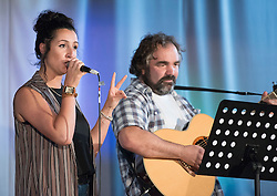 Pictured: Dundee/Glasgow duo Dodo Bus<br /> <br /> The community in Portobello came out last night in support of a locally organised campaign to try and save a local church and its attached church hall for the community. No longer needed by the church, who plan to sell it, the hall is widely used by community groups. The campaign hopes to make use of Scottish community buy-out legislation that has recently been extended to cover urban areas in one fo the first such campaigns in a Scottish urban area. Local film acting couple, Shauna Macdonald and Cal MacAninch, were instrumental in the event that featured a variety of local talent and was attended by about 150 people, packing out the church hall. Shauna brought the show together, along with her sister Kyrsta, and Cal performed on stage in both the specially written short play that opened the evening and singing with the band Hooseband at the show's finale.  <br /> <br /> <br /> © Jon Davey/ EEm