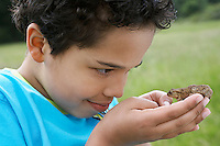 Boy (7-9) holding Toad close-up