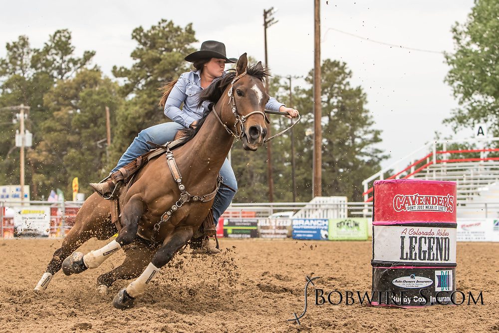 Emma Joseph makes her barrel racing run during slack at the Elizabeth Stampede on Sunday, June 3, 2018.