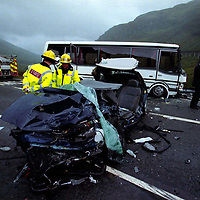 Killin firefighters and Central Police officers at the scene of the crash between a dark blue Police Vauxhall Vectra 2.0 16v and a mini coach on the A85 two miles north of Lochearnhead.<br />