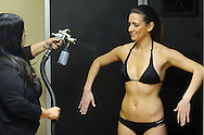 DOYLESTOWN, PA - FEBRUARY 13: Bella Sorrel manager Rachel Sanceciz applies a spray tan to Nicole Jenet  of Warrington, Pennsylvania at Bella Sorrel February 13, 2015 in Doylestown, Pennsylvania.  They operate a salon with three airbrush tanning rooms and are looking to franchise their concept across the country.  (Photo by William Thomas Cain/Cain Images)