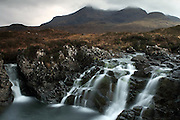 Long exposure waterfalls on a path from Sligachan up towards the Bruach na Frithe munro, part of the Cuillin mountain range in southern Skye, Scotland
