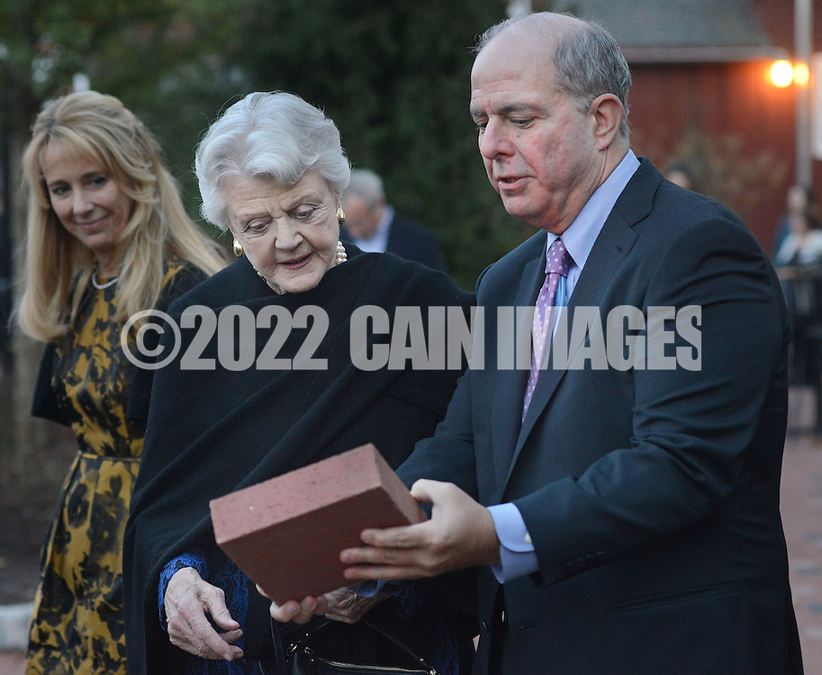 NEW HOPE, PA -  OCTOBER 28: Actress Angela Lansbury is presented with a commemorative brick to be installed in the walkway by Jed Bernstein, Producing Director of the Bucks County Playhouse October 28, 2013 at the Bucks County Playhouse in New Hope, Pennsylvania.  Lansbury,  five-time Tony Award winning actress is the first inductee of the Bucks County Playhouse's Hall of Fame.(Photo by William Thomas Cain/Cain Images)