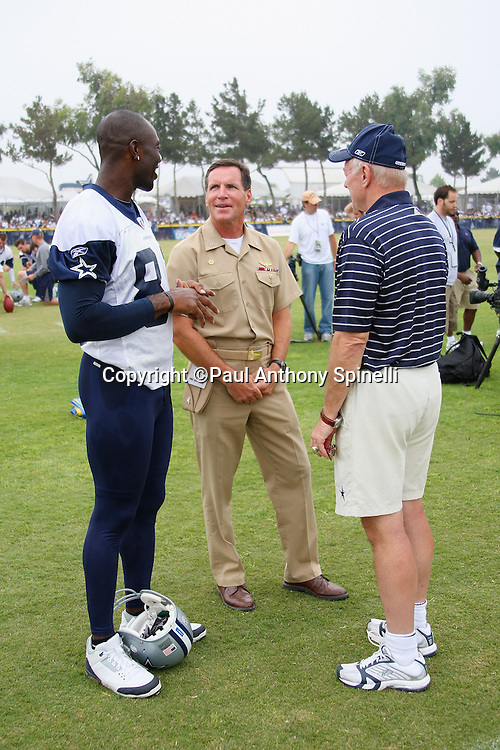 """OXNARD, CA - AUGUST 01:  Team Owner, President and General Manager Jerry Jones (right) of the Dallas Cowboys and wide receiver Terrell Owens #81 (left) of the Dallas Cowboys talk to Captain Brad """"Brick"""" Conners, the Commanding Officer of the Naval Base Ventura County, during a break in the action at the 2008 Dallas Cowboys Training Camp at River Ridge Field in Oxnard, California on August 1, 2008. ©Paul Anthony Spinelli *** Local Caption *** Jerry Jones;Terrell Owens;Brad Conners"""