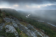 Fog rolls over the Carp River Valley at Porcupine Mountains Wilderness State Park