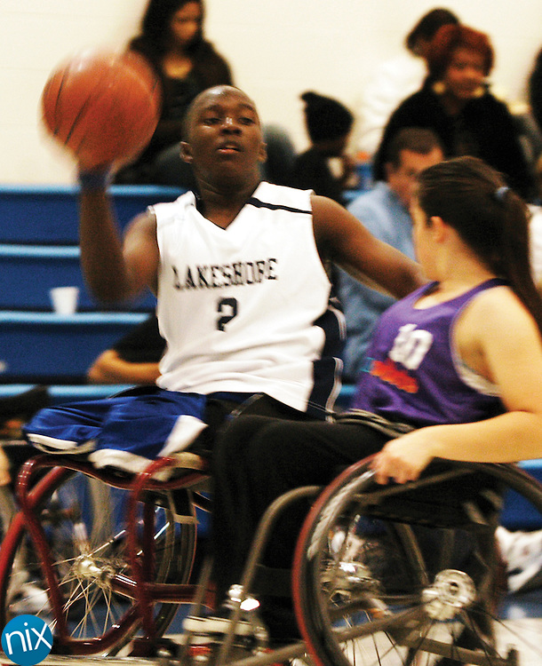 Roderick Sewell, of the Lakeshore Lakers, looks to pass during a game at the Winter Classic Wheelchair Basketball Tournament at the Cabarrus County Boys and Girls Club Saturday afternoon.
