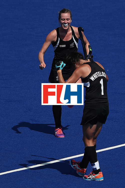 RIO DE JANEIRO, BRAZIL - AUGUST 15:  Samantha Charlton #13 and Kayla Whitelock #1 of New Zealand celebrate after defeating Australia 4-2 in the quarter final hockey game on Day 10 of the Rio 2016 Olympic Games at the Olympic Hockey Centre on August 15, 2016 in Rio de Janeiro, Brazil.  (Photo by Christian Petersen/Getty Images)