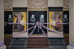 """© Licensed to London News Pictures. 06/07/2020. London, UK. Tape which reads """"Missing Live Theatre"""" covers the entrance to the Lyceum Theatre in Covent Garden. The government has announced a £1.57bn bailout for the UK arts sector, which has been especially hard hit by the economic effects of lockdown and COVID-19. Photo credit: Rob Pinney/LNP"""