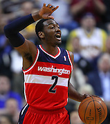 March 29, 2012; Indianapolis, IN, USA; Washington Wizards point guard John Wall (2) brings the ball up court against the Indiana Pacers at Bankers Life Fieldhouse. Indiana defeated Washington 93-89. Mandatory credit: Michael Hickey-US PRESSWIRE