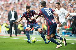 09.04.2016, Estadio Santiago Bernabeu, Madrid, ESP, Primera Division, Real Madrid vs SD Eibar, 32. Runde, im Bild Real Madrid's Lucas Vazquez and Sociedad Deportiva Eibar's Adrian Gonzalez and Antonio Luna // during the Spanish Primera Division 32th round match between Real Madrid and SD Eibar at the Estadio Santiago Bernabeu in Madrid, Spain on 2016/04/09. EXPA Pictures © 2016, PhotoCredit: EXPA/ Alterphotos/ Borja B.Hojas<br /> <br /> *****ATTENTION - OUT of ESP, SUI*****