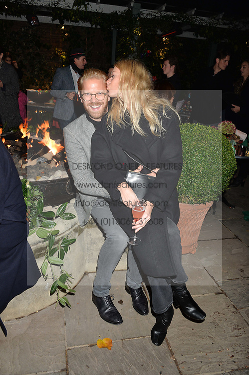The Ivy Chelsea Garden's Guy Fawkes Party & Launch of The Winter Garden was held on 5th November 2016.<br /> Picture shows:-ALISTAIR GUY and BARBORA BEDIOVA.
