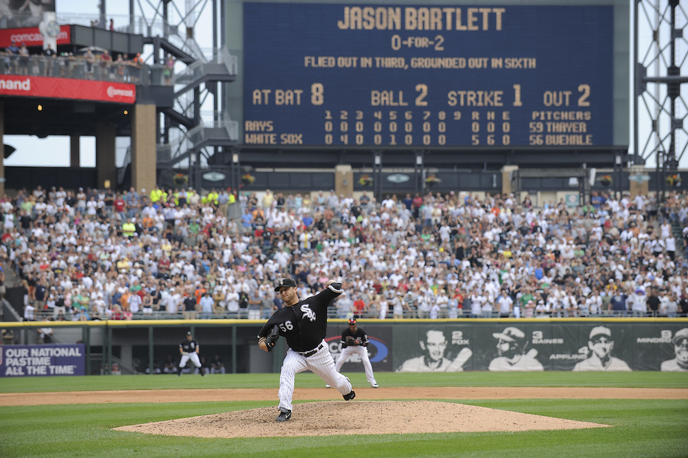 CHICAGO - JULY 23:  Mark Buehrle #56 of the Chicago White Sox throws the final pitch of the game to Jason Bartlett to record the 18th perfect game in major league history against the Tampa Bay Rays on June 23, 2009 at U.S. Cellular Field in Chicago, Illinois.  The White Sox defeated the 5-0.  (Photo by Ron Vesely)