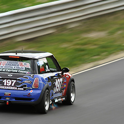 May 23, 2009; Lakeville, CT, USA; The RSR Motorsport Mini Cooper S driven by Jade Buford and Owen Trinkler races in the Grand-Am Koni Sports Car Challenge series competition during the Memorial Day Road Racing Classic weekend at Lime Rock Park.