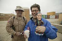 Al Franken in Afghanistan..during the USO shows in Dec 2003....with talking W puppet at Baghram Base...........USO photo by Owen Franken
