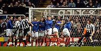 Photo. Jed Wee, Digitalsport<br /> Newcastle United v Våerenga, UEFA Cup 3rd Round, St. James' Park, Newcastle. 03/03/2004.<br /> Newcastle's Alan Shearer finds a gap in the Valerenga wall to score the opening goal.