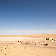 A village in the desert located near a clay pan where water may collect during rains in the Karakum, Turkmenistan