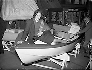 18/04/1960<br /> 04/18/1960<br /> 18 April 1960<br /> The First Annual Boat Show at  Busaras, Store Street, Dublin.<br /> Just trying it for size is Miss Pasquelle Farrell, Stepaside, Co. Dublin, a maid of the mountains who's thoughts are turning to the seas. &quot;We found Pasquelle picking a boat for herself at the first National Boat Show which opened in Dublin on Easter Monday. She hopes to join the sport this season&quot; original caption.