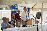 St. Johnsbury Academy Headmaster Tom Lovett speaks to the crowd during the 70th Anniversary celebration of the Kiwanis Pool in St. Johnsbury Vermont.  Karen Bobotas / for Kiwanis International