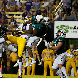 Sep 8, 2018; Baton Rouge, LA, USA; LSU Tigers wide receiver Stephen Sullivan (10) catches a touchdown pass over Southeastern Louisiana Lions defenders defensive back Zeke Walker (2) and defensive back Ferlando Jordan (23) on the final play of the second quarter of a game at Tiger Stadium. Mandatory Credit: Derick E. Hingle-USA TODAY Sports