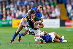 South Africa Lock Eben Etzebeth is tackled by Samoa Fly-Half Mike Stanley and Hooker Motu Matu'u - Mandatory byline: Rogan Thomson/JMP - 07966 386802 - 26/09/2015 - RUGBY UNION - Villa Park - Birmingham, England - South Africa v Samoa - Rugby World Cup 2015 Pool B.