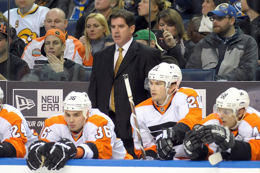 Philadelphia Flyers head coach Peter Laviolette watches play from the bench in the first period against the Buffalo Sabres at the First Niagara Center in Buffalo, NY. Buffalo leads Philadelphia 3-1 after the first period.