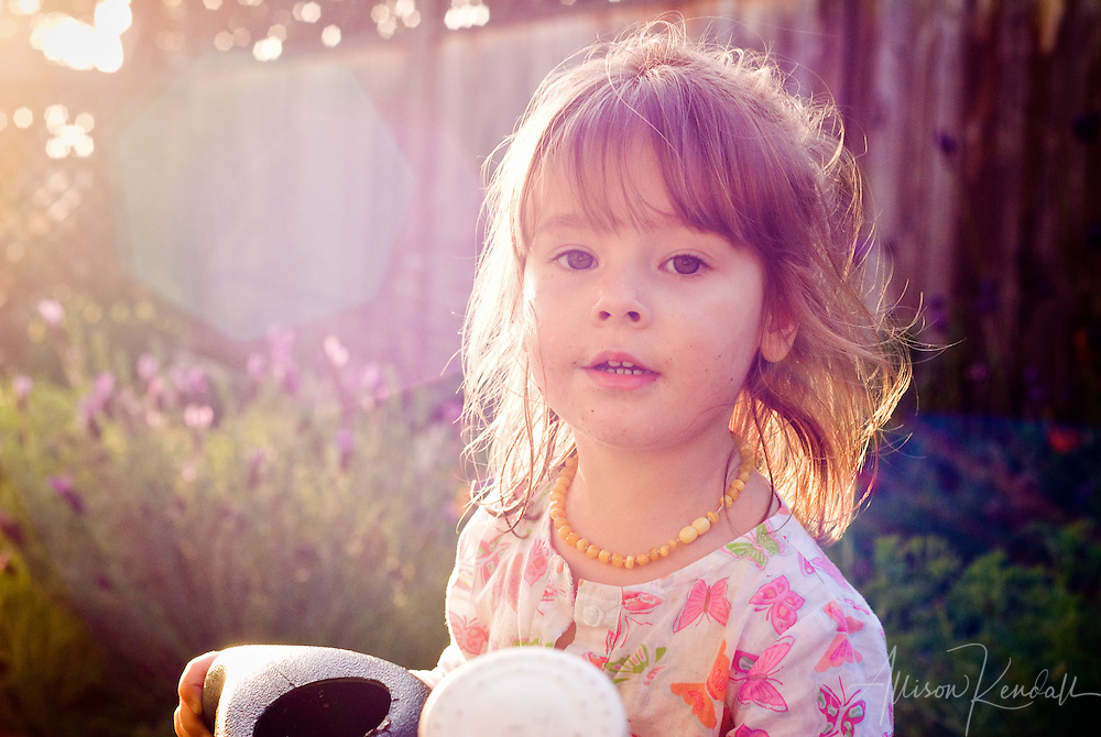 McKenna plays in the late afternoon sun of a garden in spring